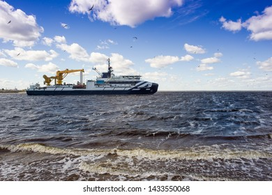 "Severodvinsk, RUSSIA - JUNE, 01, 2019. Oceanographic research vessel ""Akademik Kovalev"" goes into the White Sea. Ahead - the test of the ship."