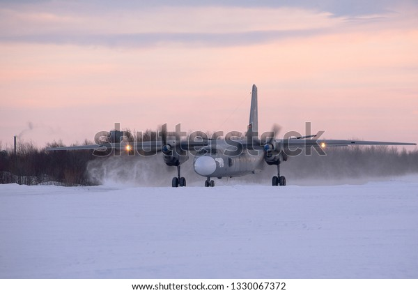 Severomorsk, Murmansk Region, Russia - February 28, 2012: Routine busy day at the airbase. Flying of An-26(is a twin-engined turboprop civilian and military transport aircraft)