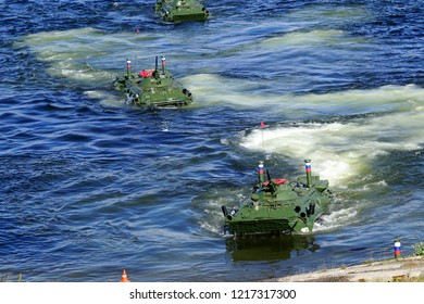 Severomorsk, Russia - July 30, 2017: Demonstration of assault from the large-scale assault battleship with the armored floating personnel carriers in the Kola Bay.