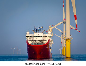 Sevice operations vessel in dynamic positioning sat of offshore wind turbine - Shutterstock ID 1936176001