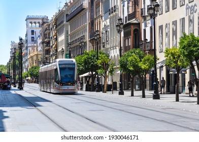 Sevilla, Andalusia, Spain - 29 Jul 2017: Tram in Seville, Plaza San Francisco. Edificio La Adriatica