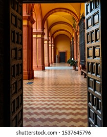 Sevilla, Andalusia / Spain - November 4, 2018:  interior passageway with impressive architecture that plays with lines, geometric shapes and orange colors, Real Alcazar, UNESCO Humanity Heritage.