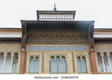 Sevilla, Andalusia / Spain - November 4, 2018:  Palace of king Pedro I facade Palacio del Rey Don Pedro, beautiful mudejar architecture with arabic decoration , Real Alcazar, UNESCO Humanity Heritage.