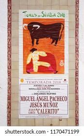 SEVILLA / SPAIN - JUNE 2018: Bullfighting poster (Toros de Sevilla) on the bullfight arena wall, advertising the next event.