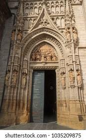 SEVILLA, SPAIN - MARCH 27, 2016: Main entrance door of Sevilla Cathedral