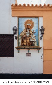 SEVILLA, SPAIN. NOVEMBER, 26 - 2018: Decorative tile of the 'Nuestra Señora del Carmen' (Our Lady of Carmen) on a wall in a street of Seville.