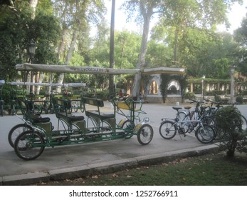 Sevilla Spain - SEPTEMBER 24, 2015: Scenic cityscape with touristic transport cycle. Seville, Andalusia, Spain.