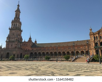 "Seville, Andalusia, Spain. Plaza de España (""Spain Square"") in the Parque de María Luisa (Maria Luisa Park). Landmark example of the Regionalism Architecture. Renaissance Revival and Moorish Revival."