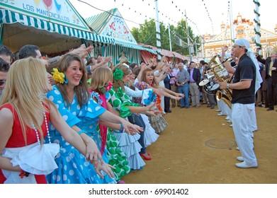 SEVILLE - APRIL 28: Spontaneous celebrations of music and dance erupt during the Feria de Abril on April 28, 2009 in Seville, Spain.