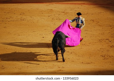 SEVILLE - APRIL 30: A bull moves toward the torero during a bullfight for a sold out crowd at the Plaza de Toros de Sevilla, April 30, 2009 in Seville, Spain.