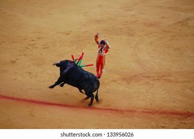 "SEVILLE - APRIL 30: Bullfighter David Fandila ""El Fandi"" sticks the banderillas into the bull at the Plaza de Toros de Sevilla April 30, 2009 in Seville, Spain."