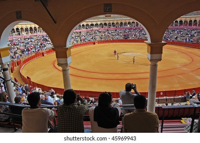 SEVILLE - APRIL 30:The ring is prepared as the spectators enter the stadium at the Plaza de Toros de Sevilla April 30, 2009 in Seville, Spain.