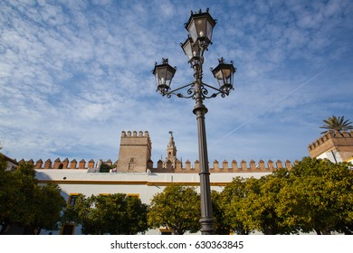 Seville cathedral Giralda tower from Alcazar of Sevilla Andalusia Spain. The Alcázar of Seville is a royal palace in Seville, Spain, originally developed by Moorish Muslim kings.