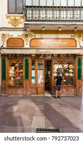 SEVILLE, ES - JULY 26, 2017: Maquedano Millinery on the street Sierpes, traditional and busy shopping street in the Spanish city of Seville, Andalusia, Spain.