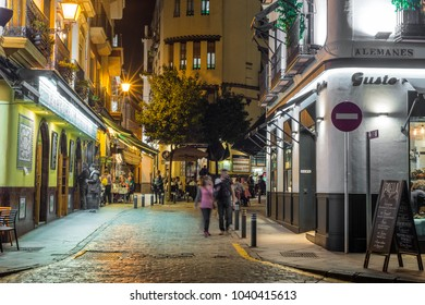 SEVILLE, ES - MARCH 8, 2017: Sierpes street is a traditional and busy commercial street of the Spanish city of Seville, Andalusia, Spain