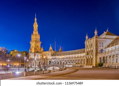 SEVILLE, ES - OCTOBER 31, 2013: Plaza de Espana is an architectural ensemble located in the Maria Luisa Park in Seville, Spain. It was built as the main building of the Ibero-American Exposition.
