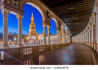 SEVILLE, ES - OCTOBER 31, 2013: Plaza de Espana is an architectural ensemble located in the Maria Luisa Park in Seville, Spain. It was built as the main building of the 1929 Ibero-American Exposition.