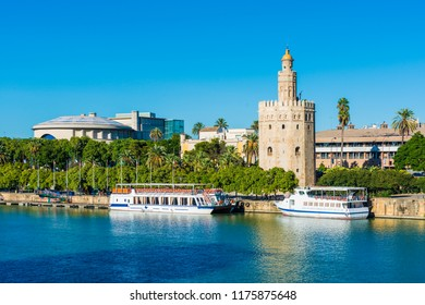 SEVILLE, ES - OCTOBER 31, 2013: The Torre del Oro in Seville is an albarrana tower located on the left bank of the Guadalquivir River. It houses the Naval Museum of Seville.