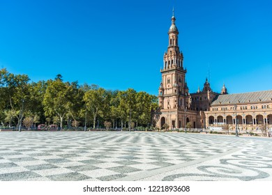 SEVILLE, ES - OCTOBER 31, 2013: Plaza de Espana is an architectural ensemble located in Maria Luisa Park in Seville, Spain. It was built as the main building of the Ibero-American Exposition of 1929.