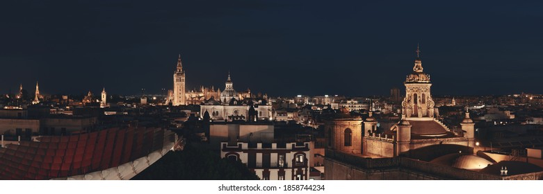 Seville night rooftop panorama view with The Cathedral of Saint Mary of the See or Seville Cathedral in Spain.