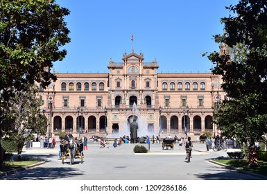 SEVILLE - SPAIN / 04.04.2017: Plaza de Espana Seville, view of tourists riding in carriages through the Plaza de Espana on a spring afternoon, Sevilla