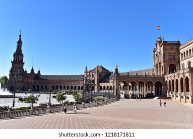 SEVILLE - SPAIN / 04.04.2017: Plaza de Espana Seville, view of people walking through the Plaza de Espana in Seville on a spring afternoon, Andalucia, Spain