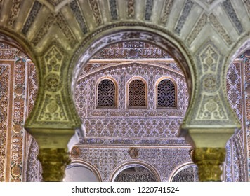 SEVILLE - SPAIN /04.05.2017: Sevilla Alcazar Ambassadors room with horse shoe arches typical moorish plaster work in Mudejar arquitecture