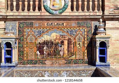 SEVILLE - SPAIN / 04.05.207: Ceramic tiles depicting Malaga in the plaza de Espana Espana