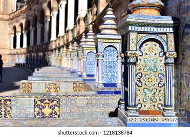 SEVILLE - SPAIN / 04.08.2017: Famous ceramic benches in Plaza de Espana, Seville, Spain