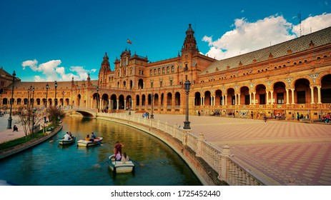 Seville, Spain - 10 February 2020 : Plaza de Espana Spain Square with Boats on the Canal in Beautiful Seville Spain City Center