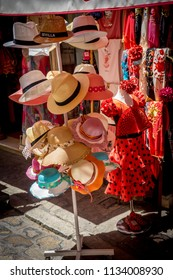 Seville, Spain : 18 June 2017: Caps and flamenco dress for sale in a shop in Seville, Spain