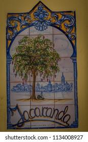 Seville, Spain - 18 June 2017:Photo of a tree on a tile in Seville, Spain, Europe