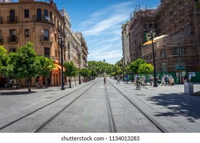 Seville, Spain - 18 June 2017:Rail lines on the street in Seville, Spain