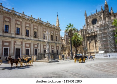 Seville, Spain - 18 June 2017:Side view of the cathedral with horse cart in front in Seville, Spain