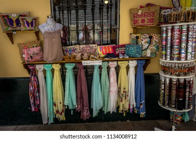 Seville, Spain - 18 June 2017:View of a scarfs and bangles on display outside a shop in Seville, Spain, Europe