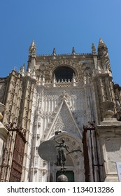 Seville, Spain - 19 June 2017:  entrance of the gothic church in Seville, Spain, Europe. The Seville Cathedral, also known as Cathedral of Saint Mary of the See is the largest cathedral in the world