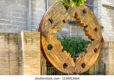 Seville, Spain - 19 June 2017:  wooden wheel of the gothic church in Seville, Spain, Europe. The Seville Cathedral, also known as Cathedral of Saint Mary of the See is the largest cathedral in  world