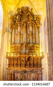Seville, Spain - 19 June 2017: organ of the gothic church in Seville, Spain, Europe. The Seville Cathedral, also known as Cathedral of Saint Mary of the See is the largest cathedral in the world