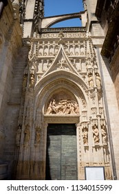 Seville, Spain - 19 June 2017: The door of the gothic church in Seville, Spain, Europe. The Seville Cathedral, also known as Cathedral of Saint Mary of the See is the largest cathedral in the world