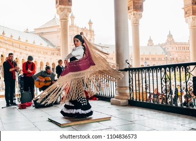 SEVILLE SPAIN, 1st MAY, 2018: Woman dancing with the traditional flamenco dress