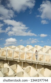 Seville, Spain apr 2 2018 Attractive young woman in Metropol Parasol looking at the cityscape