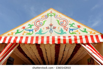 "Seville, Spain - Apr 20, 2018: A ""caseta"" stand at the Feria de Abril, where friends and family celebrate the feast of Seville Fair, Andalusia, Spain"