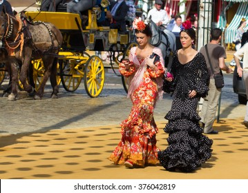 SEVILLE, SPAIN - APR, 25: women dressed in traditional costumes at the Seville's April Fair on April, 25, 2014 in Seville, Spain