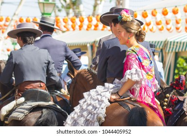 SEVILLE, SPAIN - APR: people in traditional costumes riding horse at feria de abril on April, 2014 in Seville, Spain