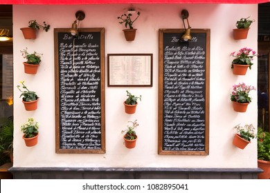 "Seville, Spain - april 02, 2018 : menu of  bar "" The star "" writing  in spanish and english languages"