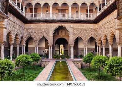 Seville, Spain - April 15, 2012: Courtyard of the Maidens (Patio de las Doncellas) in Alcazar Palace of Seville, UNESCO World Heritage Site.