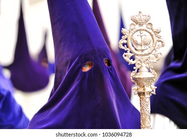 Seville, Spain - April 18, 2014: Procession of Holy Week (Semana Santa) in Seville. Holy Friday morning. closeup of Nazarene of the brotherhood of the Our Lady of Hope (Esperanza) of Triana.