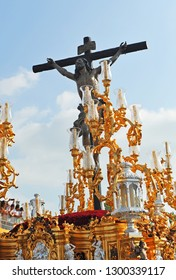 Seville, Spain - April 18, 2014: Christ of the Expiration (Cachorro) in the procession of Holy Week during the afternoon of Good Friday passing through the Triana Bridge, Seville, Spain