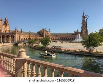 "Seville, Spain / April 18, 2017: Plaza de España (""Spain Square"") in the Parque de María Luisa (Maria Luisa Park). Landmark example of the Regionalism Architecture. Renaissance and Moorish Revival."