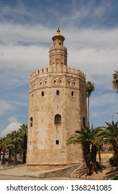 SEVILLE, SPAIN - APRIL 2, 2019: The Torre del Oro (Golden Tower) on the banks of the Guadalquivir river. Dating from 1220, the former watchtower now houses the Maritime Museum.